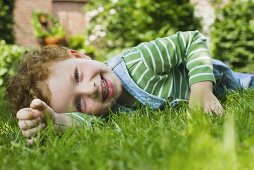 A picture of a boy lying on the grass