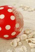 Plastic ball in sand