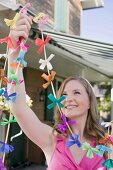 Woman with coloured garlands for garden party