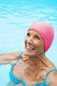 Germany, senior woman in pool