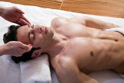 Wellness: man receiving facial massage
