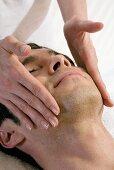 Man receiving facial massage