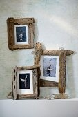 Three wooden photo frames on wall