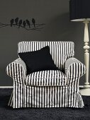 Black and white striped armchair with black scatter cushion