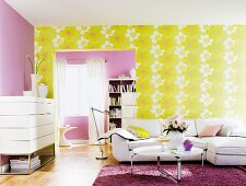 Living room with white furniture, lilac wall and yellow wallpaper with large floral pattern