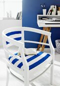 White-painted wooden chair with blue and white striped upholstery