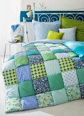 Iron bed with patchwork quilt in bedroom