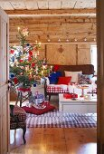 A decorated Christmas tree in a rustic living room