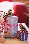 Wrapped Christmas presents decorated with birds