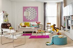 A living room in a mixture of styles with touches of colours and children's accessories
