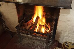 A fire burning in an old-fashioned fireplace