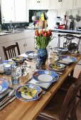 A table laid in the kitchen of a country house