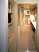 View through a door opening into a narrow hallway with integrated home office