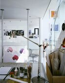 Artist's or architect's work space with stainless steel desk lamps beside with construction materials used for model making