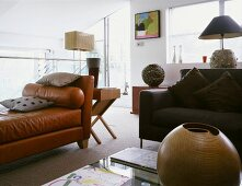 Brown leather divan and modern sofa in an open living room