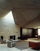 Living room with futuristic architecture with assorted seating in a mix of styles