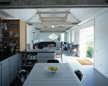 Open living room with dining room in the kitchen area in a converted barn