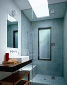Contemporary bathroom with glass shower stall (at floor level)