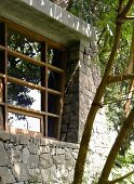 Stone facade of house with modern lattice windows