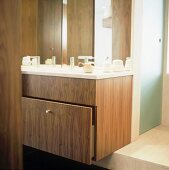 A modern wash stand with a built-in wooden drawer