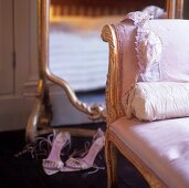 Women's underwear on an antique chair with a pink satin cover