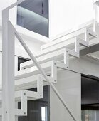 Zigzag steel profile and minimalistic handrail of light, white staircase