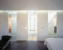 View of swing through stairwell window of designer bedroom