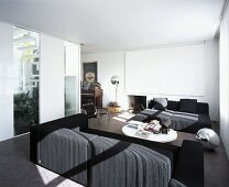 Light and shade on anthracite sofas in white, modern living room