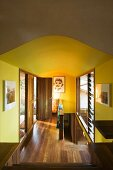 Hallway with wooden floor and yellow walls