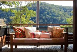 Sofa with scatter cushions on terrace