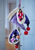 Purple velvet Father Christmas hats filled with presents