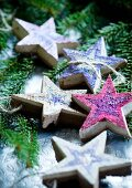 Hand-crafted wooden stars as Christmas tree decorations