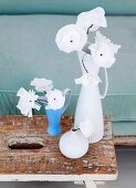 Light-as-a-feather, hand-made silk flowers in porcelain vase on stripped vintage footstool