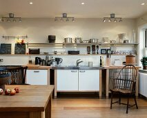 Modern kitchen with kitchen table and antique wooden chair