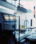 Designer workbench-style, stainless steel kitchen counter