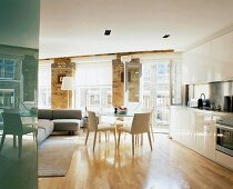 Dining area and kitchen in open-plan, modernised living space