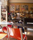 Orange plastic chair at metal table in nostalgic kitchen