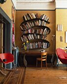 Mix of styles in traditional living room with curved designer bookcase above postmodern table