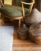 Set of baskets next to 50s-style armchair