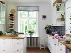 Country-house kitchen with white fronts