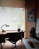 Fifties-style home office with vertical blinds on window
