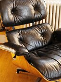 Armchair with brown leather upholstery