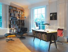 Desk with bookcase and leather armchair