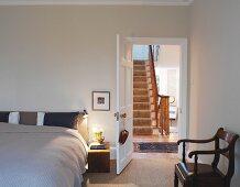 Bedroom with view to stairs through open door