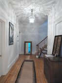White hall with wooden chest