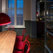 Historic charm with pink lamps and coffee house chairs in London coffee bar