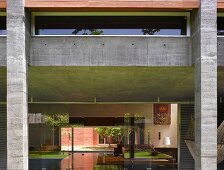 View into house with open-plan living space & courtyard