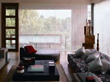 Living room with sofa, chaise longue & coffee table