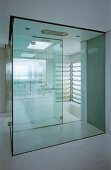 Bathroom with glass shower cubicle & sunken bathtub