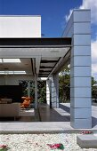 Tiled veranda & living room with open sliding door